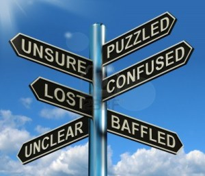 13564622-puzzled-confused-lost-signpost-shows-puzzling-problem